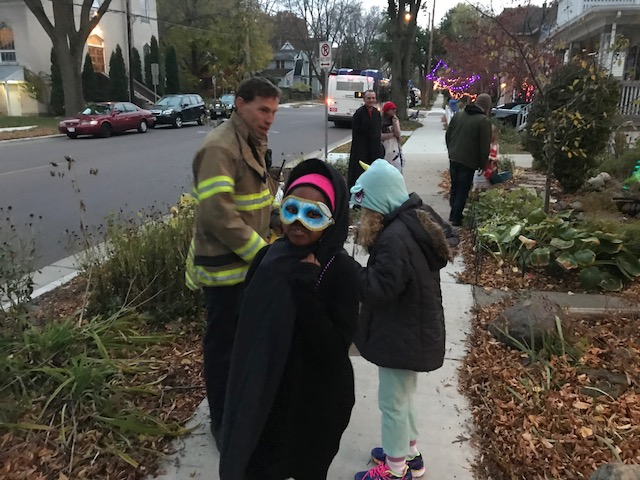 Firefighter Kearney with trick-or-treaters