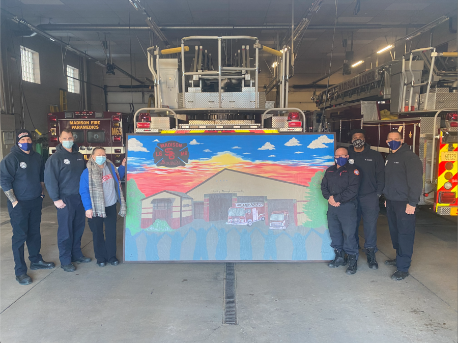 Betty Groom and Station 6 firefighters standing by painting