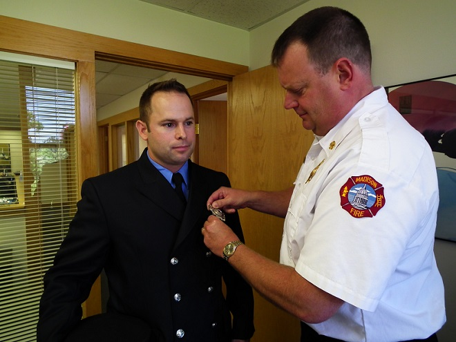 Chief Davis pins the badge