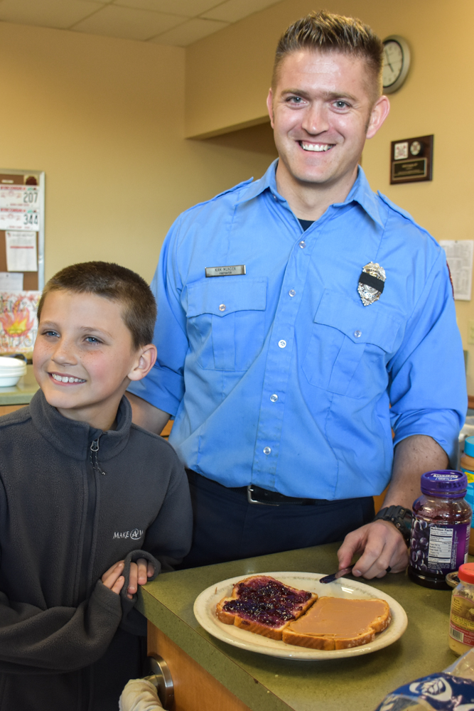 Brady with Firefighter Munden