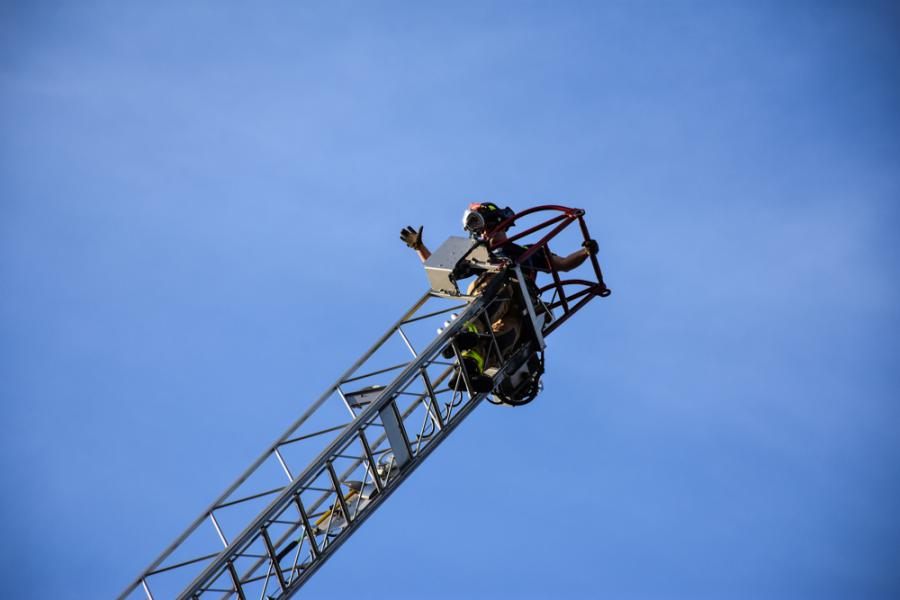 Firefighter Dykstra at top of aerial ladder