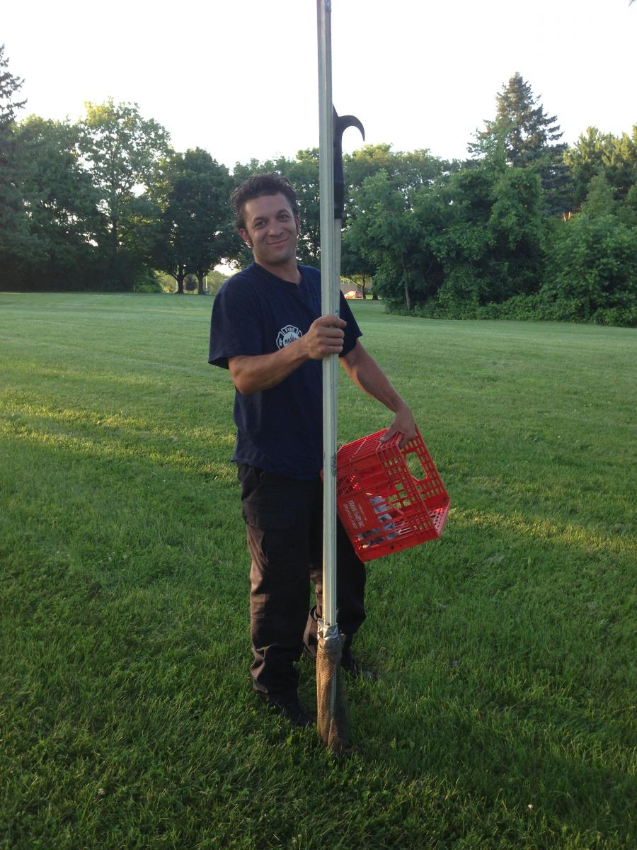 Firefighter Jadon Beehner with pike pole and milk crate