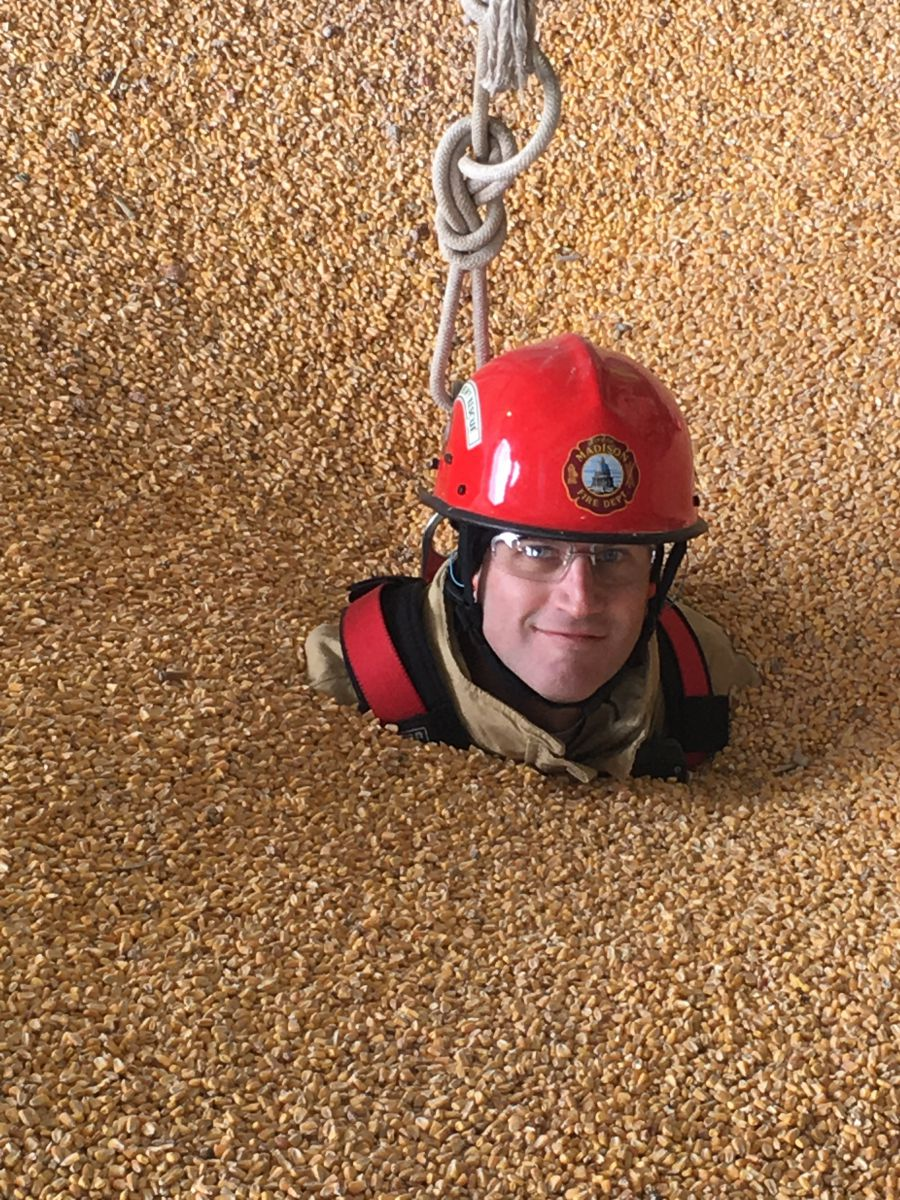 Firefighter McGinnis in corn-filled grain bin