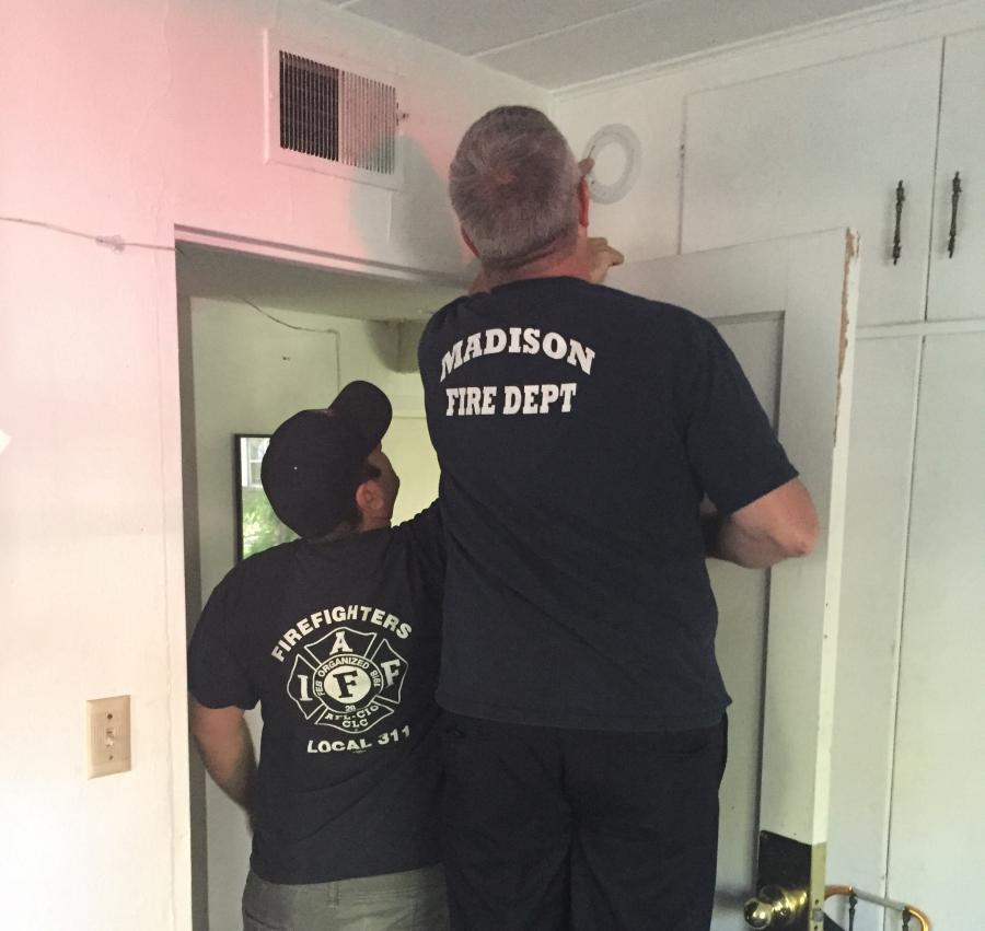 Firefighters install smoke detector
