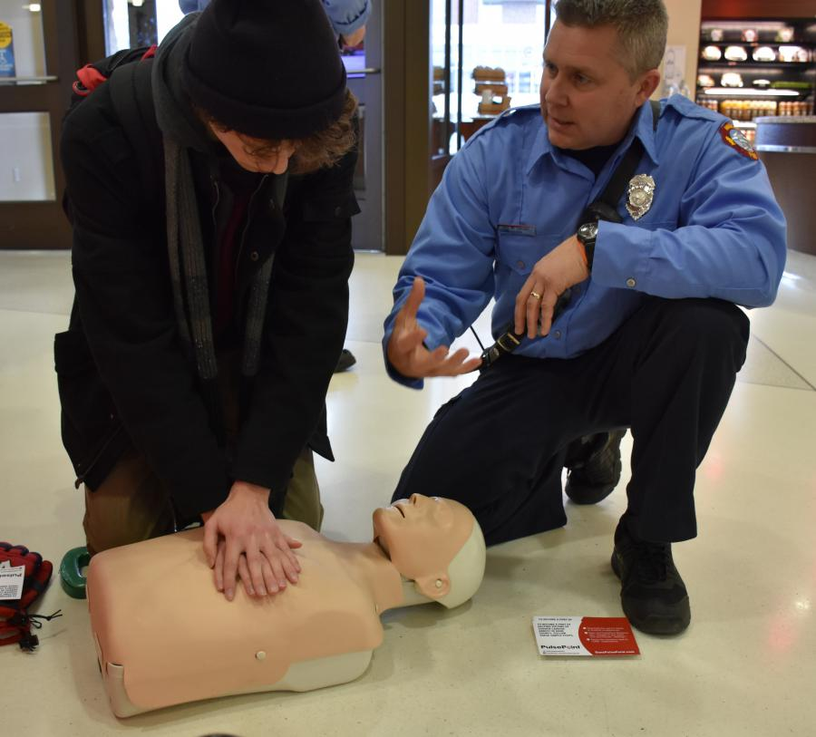 Lt. McCartney and UW student practicing CPR
