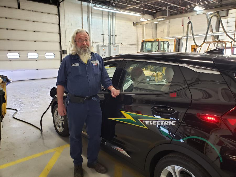 John in front of Part's Chevy Bolt