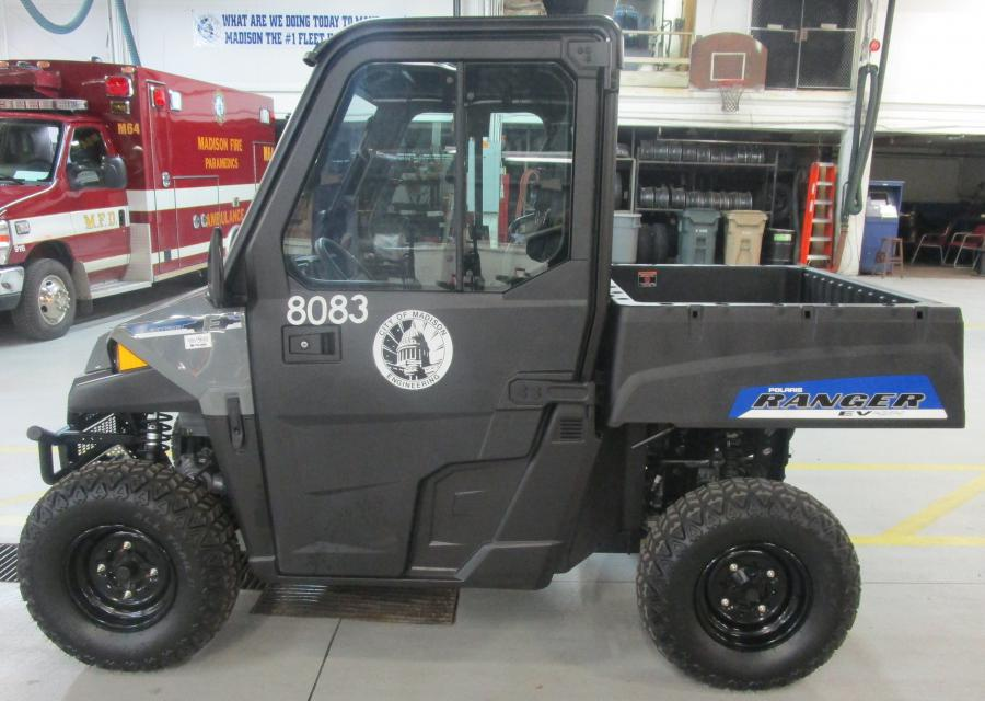 Polaris Ranger EV parked inside