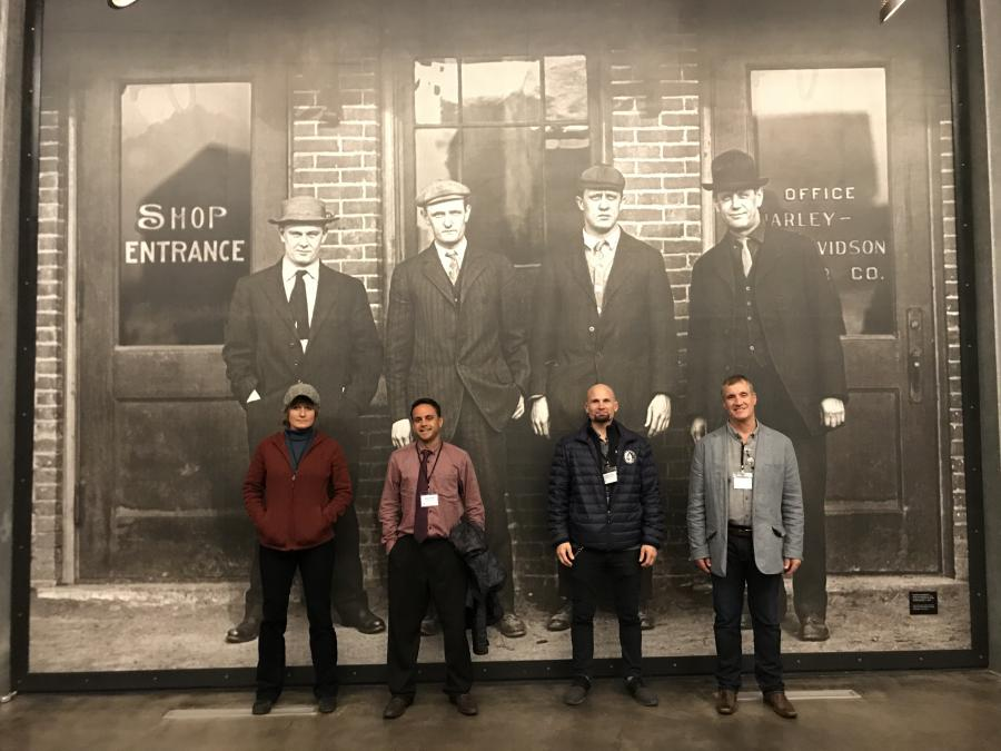 City staff posing with Harley Davidson founders photo