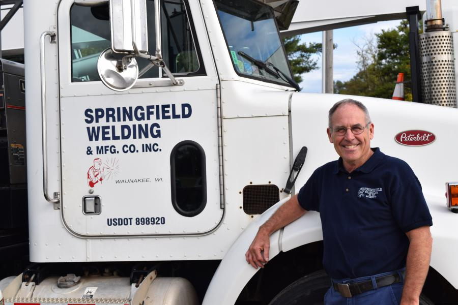 Gary Acker standing with Springfield Welding truck