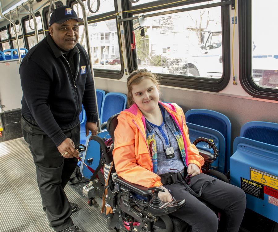 Driver securing wheelchair on Metro's fixed-route bus