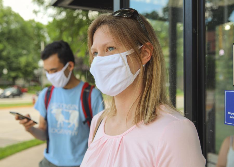 riders wearing face masks