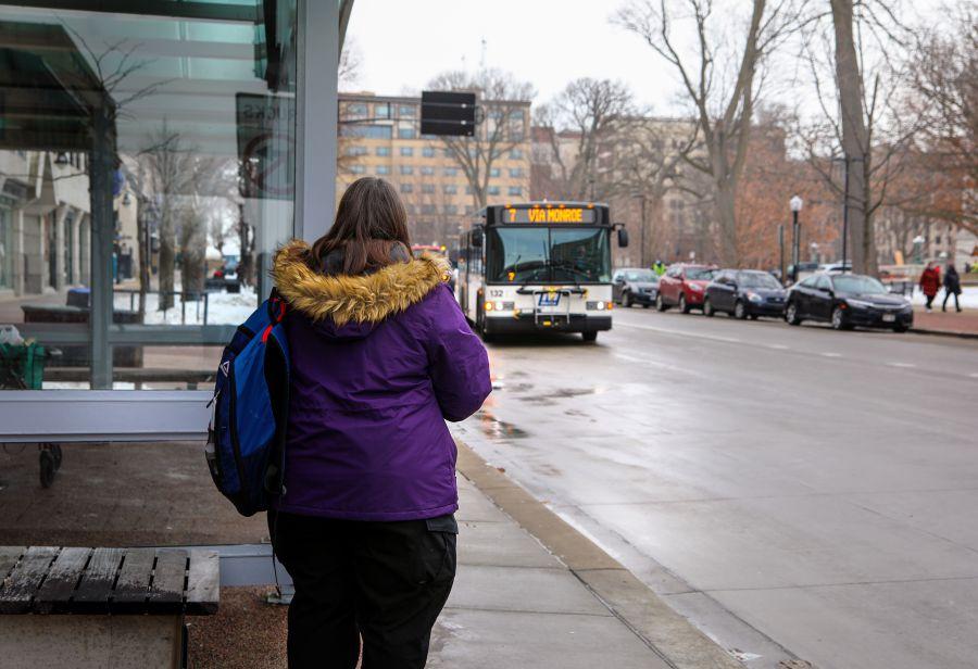 woman waiting at Capitol Square shelter
