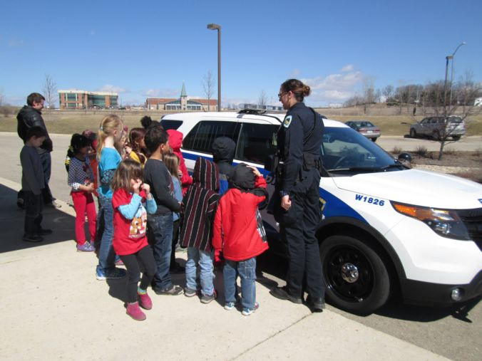 Children check out squad car
