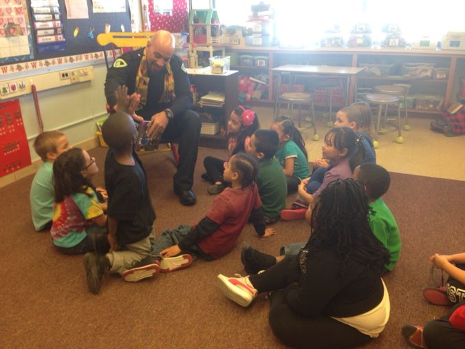 MPD Officer reads to children