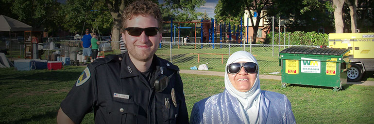 Officer and citizen smiling