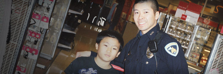 Officer and child in store