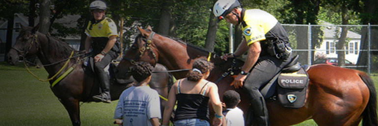 Mounted Patrol officer assisting a family