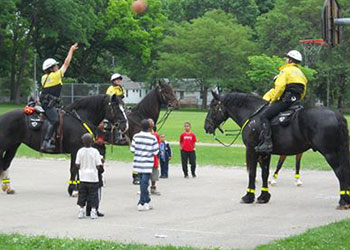 Mounted Patrol plays basketball at Darbo neighborhood party