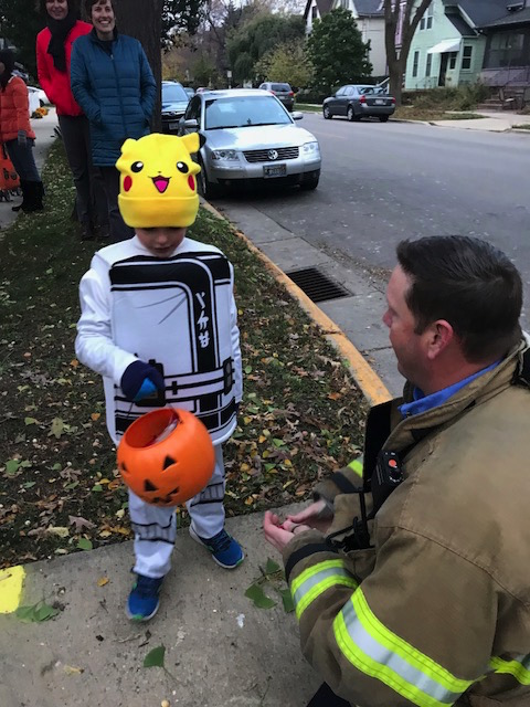 Lt. Homman handing out candy