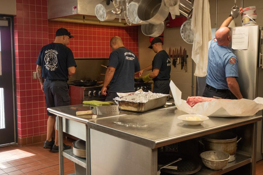 Station 1 Mealtime - Cooking for ten is always a team effort.