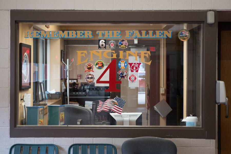 Station 4 Watch Room - Patches from other U.S. fire departments adorn the window of the Station 4 watch room.