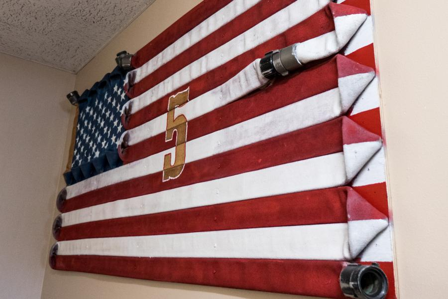 Fire Hose Flag - A custom flag made of painted fire hose was crafted for Station 5 by late firefighter Richard Garner, who began his career at Station 5.