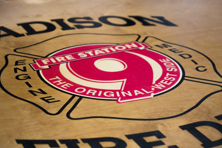 Station 9 Table - Station 9's kitchen table features a custom-made emblem at the center.