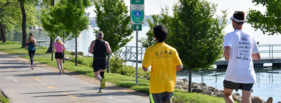 Group of runners on the Capital City Trail near Lake Monona