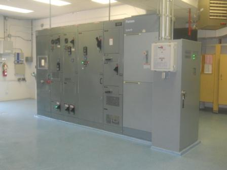 The new Motor Control Center.  The green light in the center panel shows the well pump running.