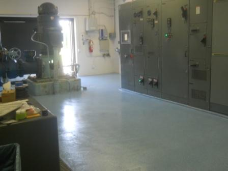 Shiny new epoxy floors.  The well pump is to the left, the Motor Control Center to the right.