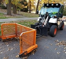 A leaf pusher ready to collect some yard waste