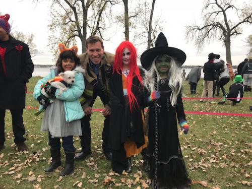 Firefighter Patrick Kearney with kids in witch costumes