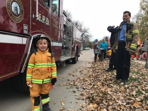 Kid in firefighter costume with Engine 3