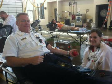 Asst. Chief Clay Christenson donates blood