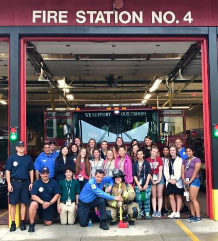 Campers with firefighters and paramedics at Station 4