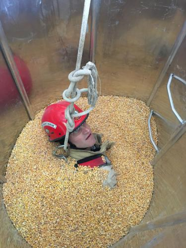 Firefighter McGinnis inside grain bin tube