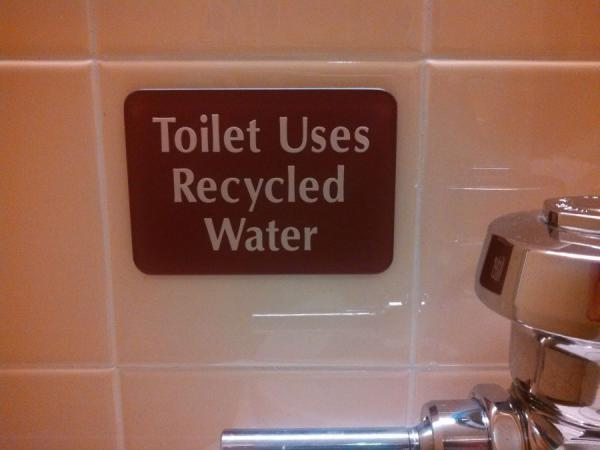 Toilet uses recycked water sign