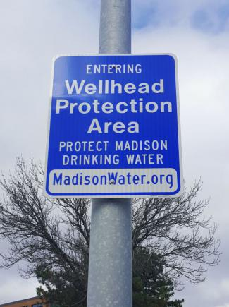 Wellhead protection sign