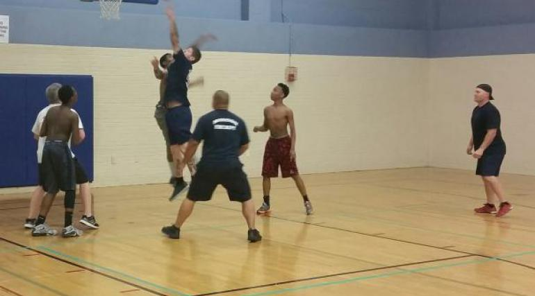 Firefighters playing basketball