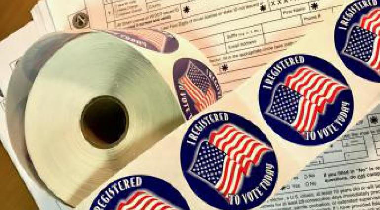 I Registered to Vote stickers with voter registration forms