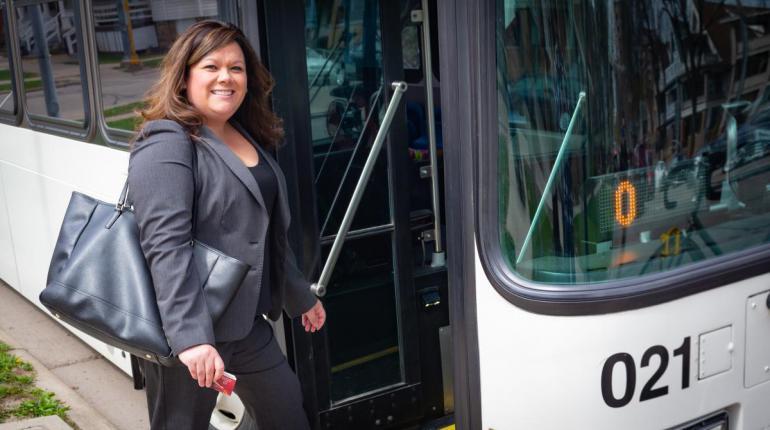 Woman boarding bus.