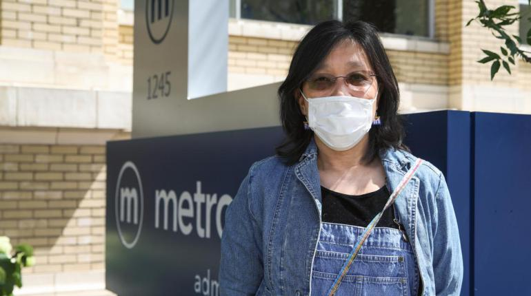Metro rider wearing a face mask.