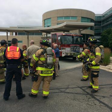 Firefighters during a briefing outside UW Health Clinic