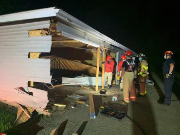 Firefighters shoring up damaged garage