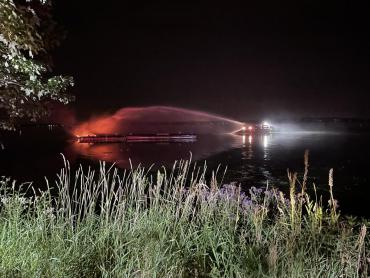 View of Lake Rescue 1 attacking the boat fire, as seen from shore