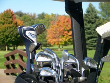 golf clubs closeup with fall background