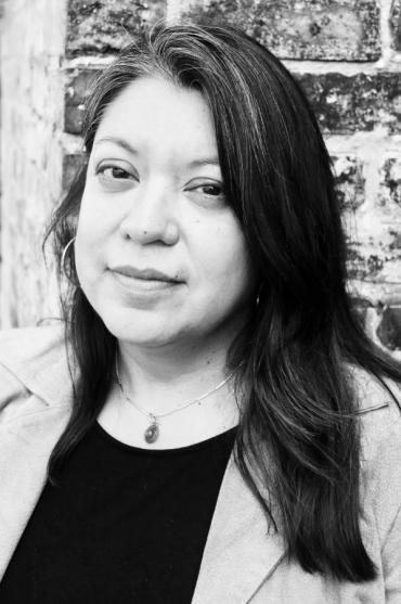 Black and white headshot of Madison Poet Laureate Angela Trudell Vasquez