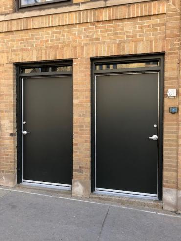 Example of two downtown doors before art is installed on them.