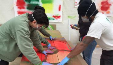 "Still shot of community engaged artmaking from Film ""Civic Art: Four Stories from South Los Angeles"""