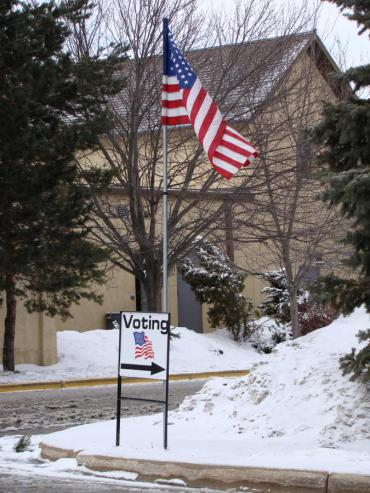 Polling Place sign in the snow